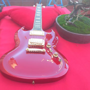 CAMBIO GIBSON SG DIABLO CARVED RED METALLIC.