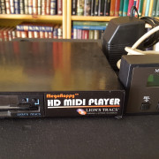 (o cambio) MIDI PLAYER MEGAFLOPPY HD. (LION,S TRACS)