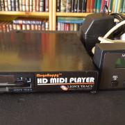 (o cambio) MIDI PLAYER MEGAFLOPPY HD. (LION,S TRACS)