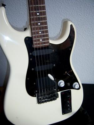 o cambio guitarra Casio Midi MG-510