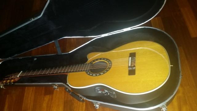 O cambio Guitarra OVATION nylon  1773LX EEUU